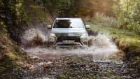 Mitsubishi Outlander PHEV Hybrid fahrend Offroad