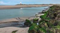 Leuchtturm und Strand im Nationalpark Texel in Holland
