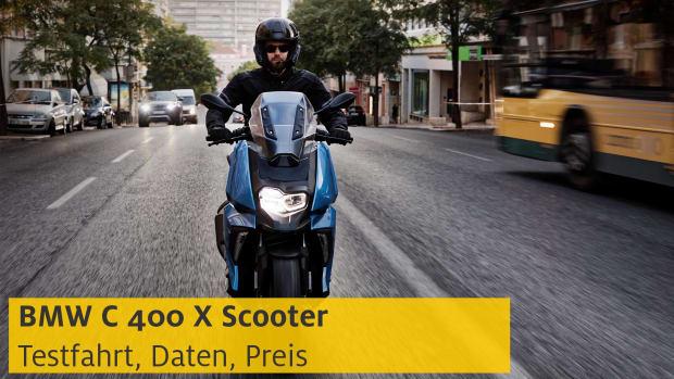 Mann fährt mit BMW C 400 X Scooter auf einer Straße